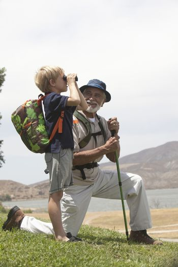 Grandfather and grand-son bird watching