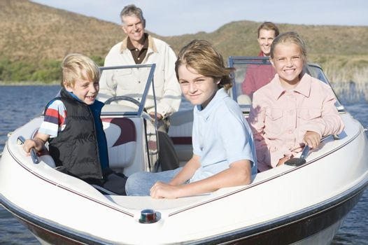 Family of five in speedboat on lake