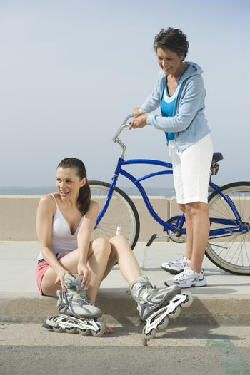 Mature and mid adult woman prepare for exercise