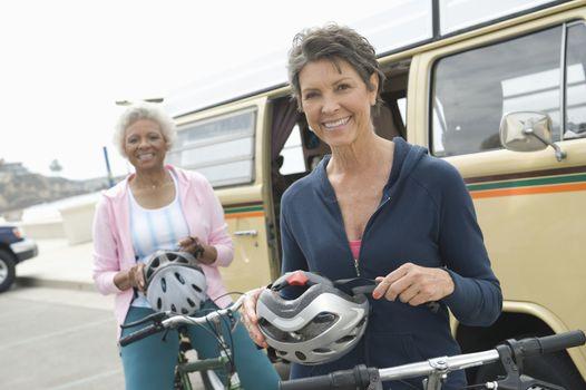 Senior women prepare for cycle ride