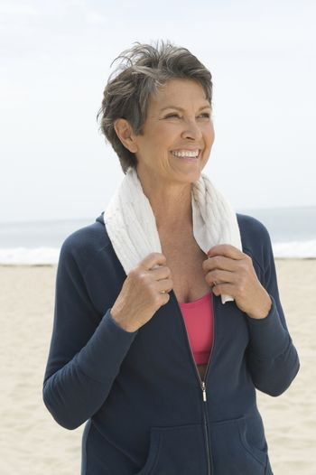 Mature woman with towel around her neck