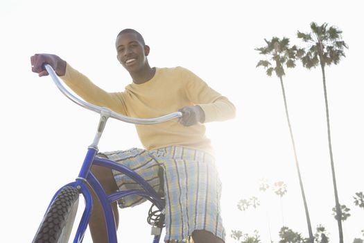 Man with bike on beach