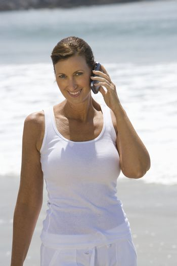 Woman on mobile phone at the beach
