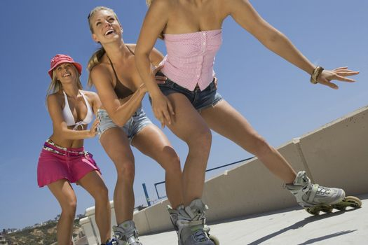 Young women on rollerblaeds