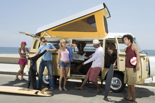 Group of young people by camper van