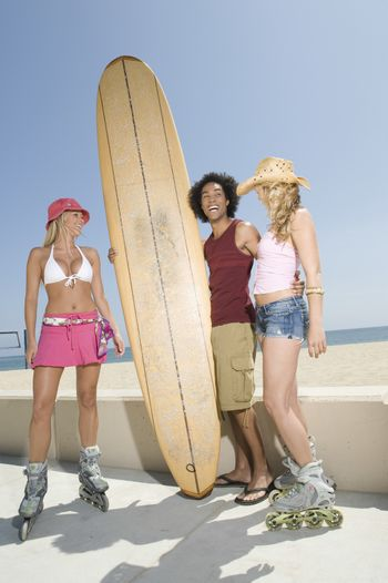 Young people with surfboard