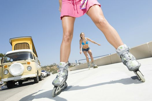 Young women on rollerblades