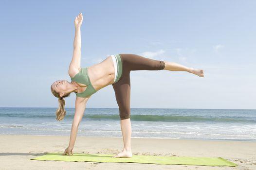 Woman exercising at beach
