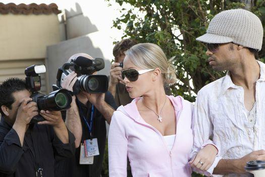 Celebrity couple and paparazzi