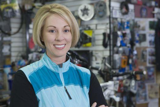 Mature woman stands in bike shop