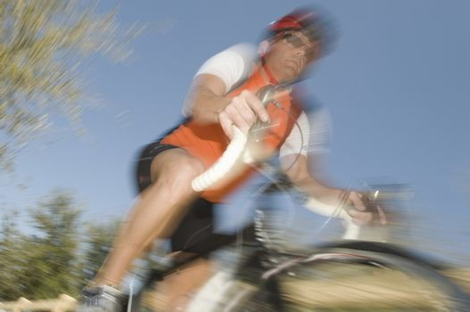 Male cyclist blurred motion