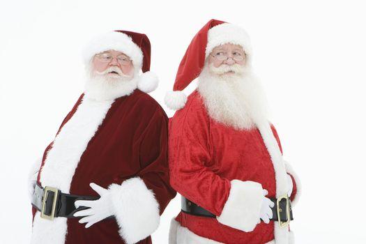 Two men dressed as Santa Claus