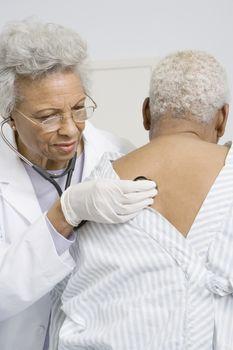 Senior medical practitioner examines breathing