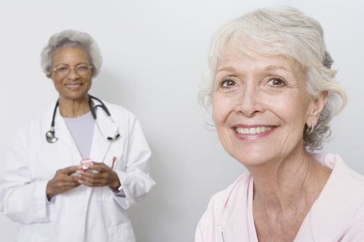 Portrait of senior medical practitioner and patient