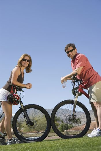 Mature couple on cycling holiday face to face
