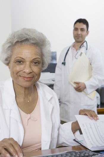 Senior medical practitioner and clipboard