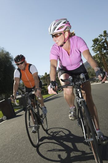 Mid adult road cyclists