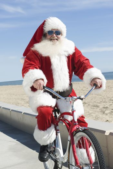 Father Christmas cycles along promenade