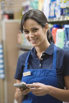 Supermarket employee in blue apron