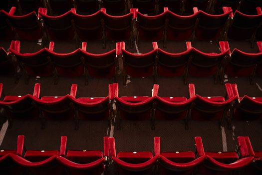 View of an empty theatre with red seats in row