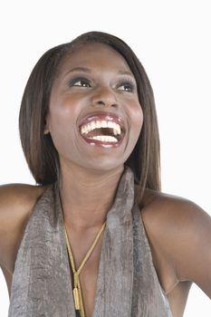 Model in grey halter laughing