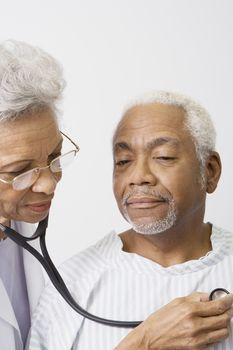Senior medical practitioner examines breathing with stethoscope