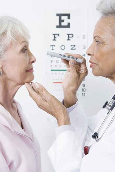 Senior medical practitioner examines eyesight