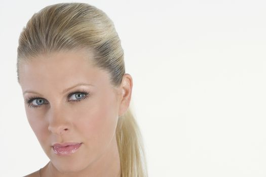 Portrait of woman with blonde ponytail