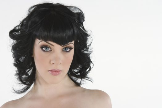 POrtrait of young woman with black hair and blue eyes