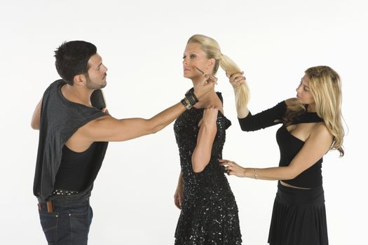 Fashion stylists attend to model