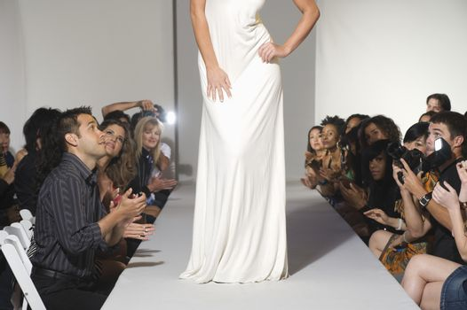 Low section of woman on fashion catwalk