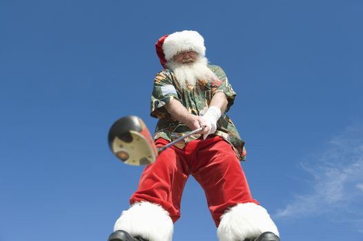 Father Christmas stands with gold club