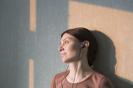 Redhead listens to headphones
