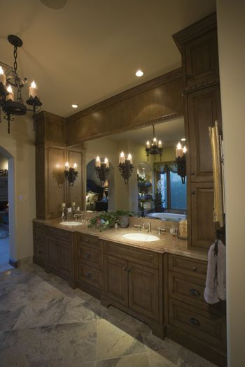 Bathroom view with lit chandelier and reflection