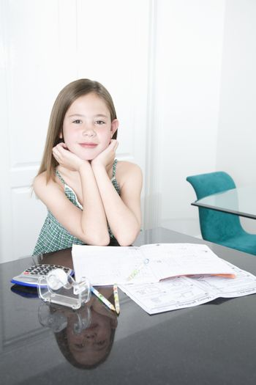 Young Teen doing her homework