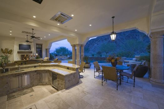 Sitting area by sunken kitchen with view of porch at home