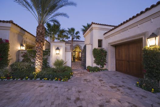 Lit driveway exterior of Palm Springs home