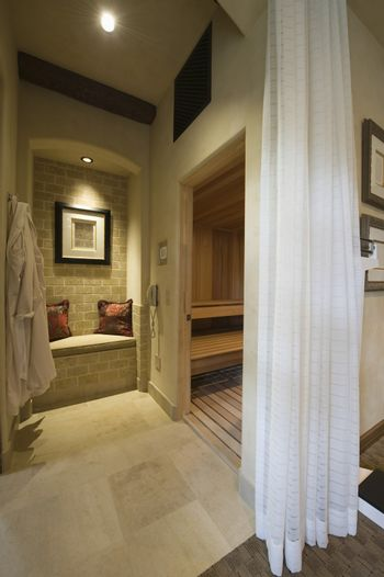 View of curtained sauna and steam room at modern home
