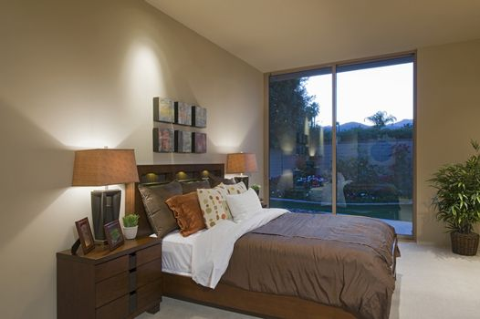 Matching bedside lamps at home with view of porch