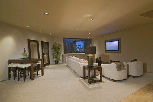 Spacious white entertainment suite at luxury home