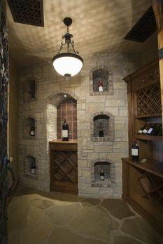 View of bottles in wine cellar