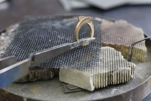 Jewellery making hand crafting a metal ring