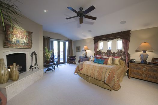 Ceiling fan in a spacious and modern bedroom at home