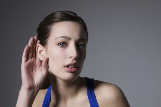 Brunette with hand behind ear