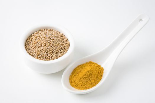 Turmeric Powder And Mustard Seed In Bowl