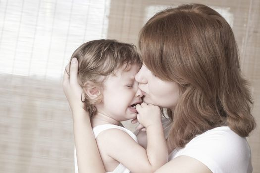 Mother comforts crying child