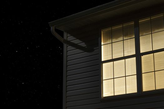 Lit window of building exterior at night