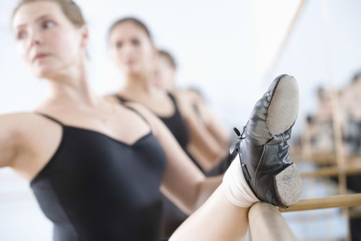 Women stretching at the barre