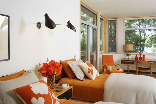 Twin beds with contrasting printed fabric cushions