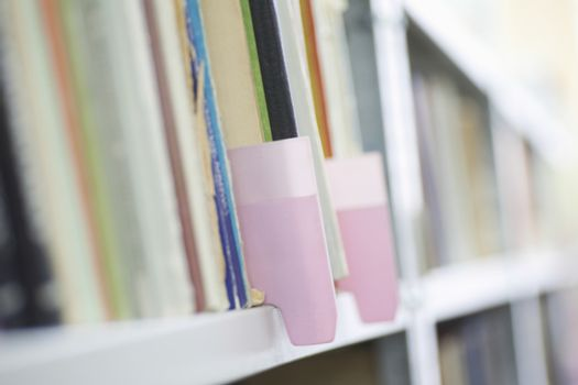 Color coded filing system on library shelves